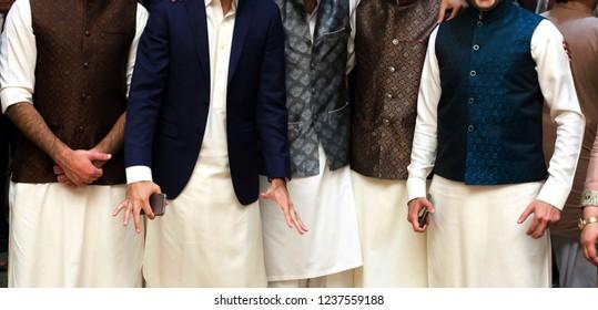 Pakistani Indian Groomsmaid wearing traditional wedding dress