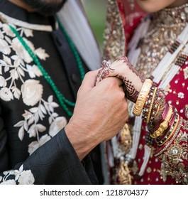 Pakistani Indian lovebirds holding hands and bridal hand mehndi design