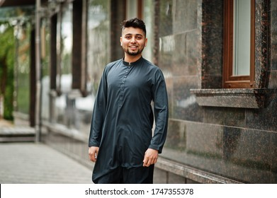 Сonfident pakistani indian muslim arabic boy in grey kameez shalwar suit.
