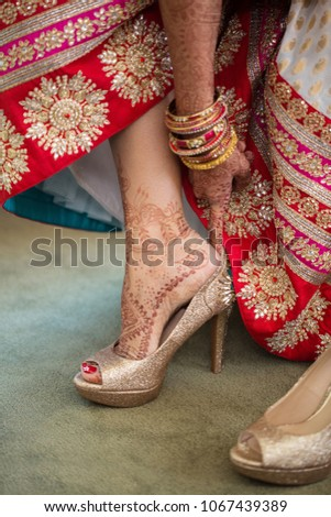 4dae30f9809 Pakistani   Indian Wedding bridal wearing shoes Bridal getting ready  wearing sandals