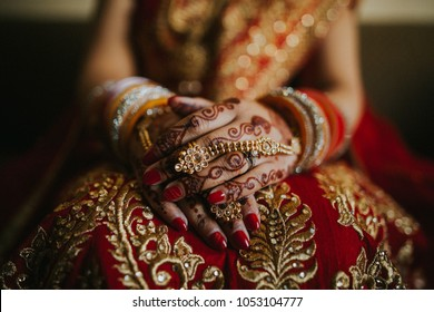 Pakistani Indian Wedding Bride Showing Henna Designs and jewelry