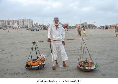 Pakistani Man Selling Some Items in Karachi Clifton Beach, Karachi, Sindh, Pakistan, 17th May 2016