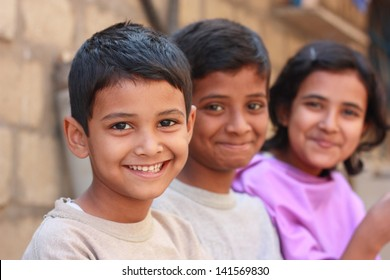 Pakistani siblings making pose and smile