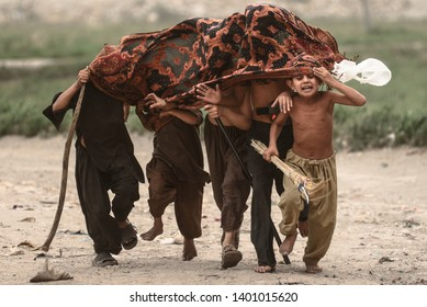 Pakistan-Lahore, Afghan refugees kids playing in mud storms on May 15,2017.