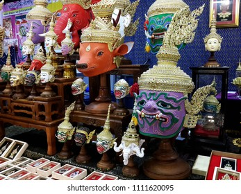 PAKKRET, NONTHABURI, THAILAND - JUNE 12, 2018: A A participant to an OTOP  -that stands for One Tambon One Product-  fair displays colourful Khon masks at Impact Challenger on June 12, 2018 in Pakkret
