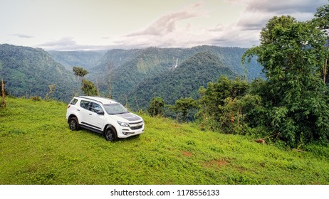Paksong district, Laos, on 12 of September 2018. it is a Chevrolet Trailblazer with beautiful view of natural such as waterfall, mountain, coffee farm and the best fresh air in Laos, even asian.