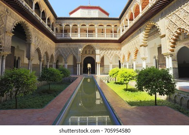 Palace of Alcazar, Famous Andalusian Architecture. Old Arab Palace in Seville, Spain. Moorish Ornamented Arches, fountain and Columns