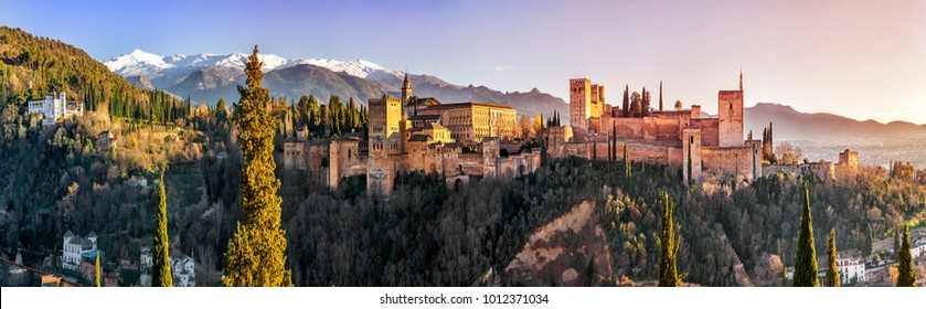 Palace and fortress complex Alhambra with Comares Tower, Palacios Nazaries and Palace of Charles V during sunset in Granada, Andalusia, Spain.