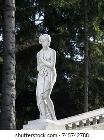 """The palace and park ensemble of Peterhof. St. Petersburg. Russia. September. 17. 2017. Marble sculpture of Venus. Cascade """"Golden Mountain"""". The western part of the Lower Park in Peterhof."""