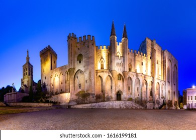 Palace of the Popes, once fortress and palace, one of the largest and most important medieval Gothic buildings in Europe, at night, Avignon, France