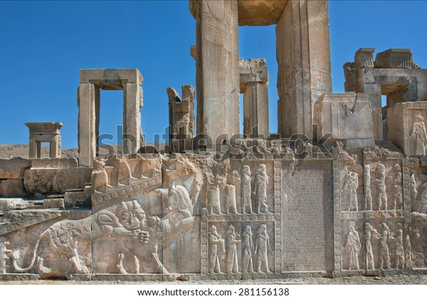 Palace in ruins with ancient bas-relief of Zoroastrians and figures of people and animals in Persepolis, Iran. Persepolis was a capital of the Achaemenid Empire (550 - 330 BC)