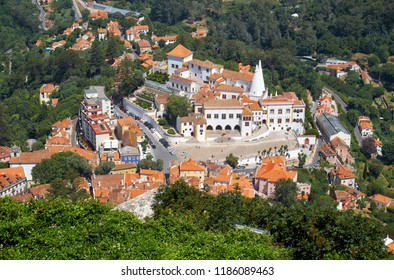 The Palace of Sintra (Town Palace), the medieval royal residence located in the center of Sintra town as seen from the Moorish castle on the top of the hill. Sintra. Portugal