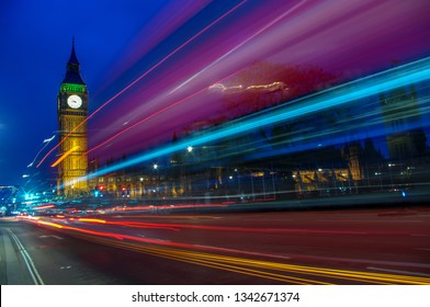 Palace of Westminster / Elizabeth Tower with light trails from a passing bus