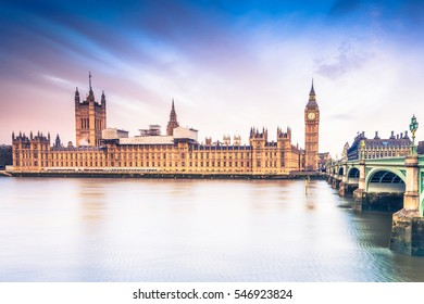 Palace of Westminster at sunrise, reflection in river Thames
