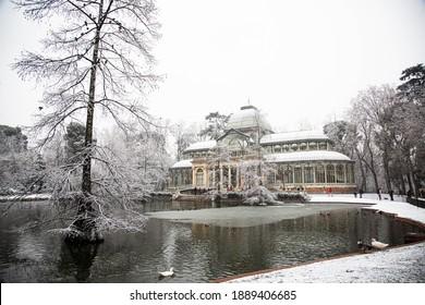 Palacio de Cristal under the snow in El Retiro Park, in Madrid. January 2021