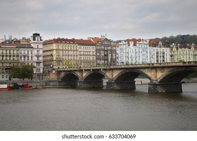 Palackeho bridge over Vltava river in Prague with historic apartment buildings. Czech Republic.