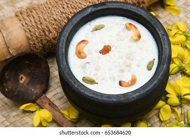 Palada Payasam/ Pradhaman/ Kheer/ Mithai seasonal sweet dish Kerala South India for Onam, Vishu, Bihu, Bisu festival. Popular Indian dessert /confectionery with rice in clay mud  pot  earthen ware.