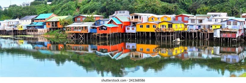 Palafitos in front of the seashore, the traditional houses of wood from the Chiloe Island