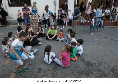 PALAICHORI, CYPRUS - MAY 25: Young teenage Kids playing traditional easter games at the village of Palaichori in Nicosia district on May 25 2016 in Cyprus