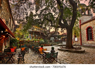 "PALAIOS PANTELEIMONAS VILLAGE, GREECE- November 24, 2014. The picturesque square of Palaios (""old"") Panteleimonas village around sunset , Pieria, Macedonia, Greece"