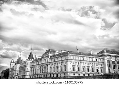 Palais de la Cite in Paris, France. Palace building with towers on cloudy sky. Monument of gothic architecture and design. Vacation and wanderlust in french capital.