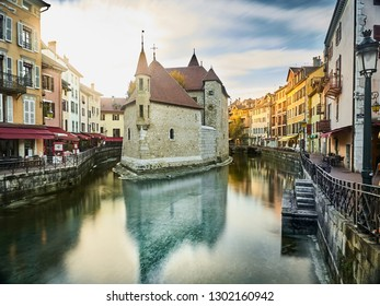 "The ""Palais de l'Ile"" in Annecy, a historical building placed on a small island of the river Thiou, which runs inside Annecy. The building was a prison in the past, now it's a museum"