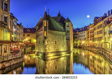 Palais de l'Ile jail and canal in Annecy old city by night, France, HDR