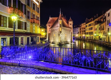 "Palais de l'Isle, the medieval castle in Annecy, the capital of Savoy, called ""Venice of the Alps"", France, illuminated in the night"