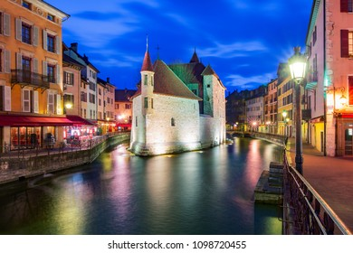 The Palais de l'Isle and Thiou river during morning blue hour in old city of Annecy, Venice of the Alps, France