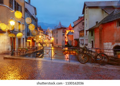 The Palais de l'Isle and Thiou river in the rainy morning in old city of Annecy, Venice of the Alps, France
