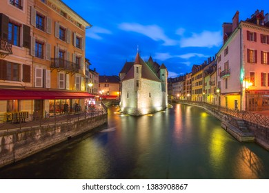 The Palais de l'Isle and Thiou river at night in old city of Annecy, Venice of the Alps, France