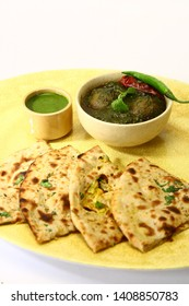 Palak Kofta or Masala Chees with spinach with Paratha, Indian Food