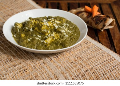 Palak paneer is a delicious and nutritious dish from North Indian cuisine. Cottage cheese cubes are cooked with mildly spiced palak gravy.