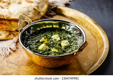 Palak Paneer indian food with cheese and spinach in Kadai dish and Naan bread