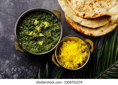 Palak Paneer indian food with cheese and spinach, Naan bread and Basmati Rice with Saffron in Kadai dish