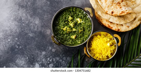 Palak Paneer indian food with cheese and spinach, Naan bread and Basmati Rice with Saffron in Kadai dish copy space