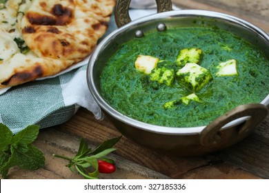 Palak Paneer with Naan served in Kadai, selective focus