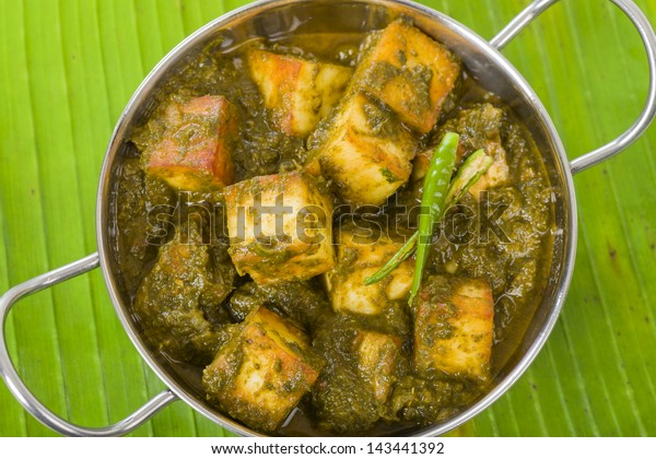 Palak Paneer - South Asian curry made with paneer (cheese) with pureed spinach sauce.