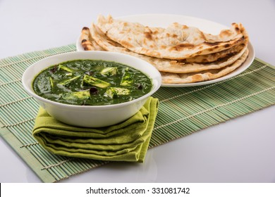 Palak paneer or Spinach and Cottage cheese curry is a healthy main course recipe in India, served with roti/chapati or naan, selective focus