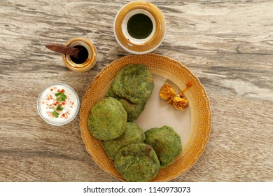 Palak Puri is a delicious and healthy puri is served as a breakfast or snack. This puffy puris are enjoyed hot and is traditionally served with potato curry.