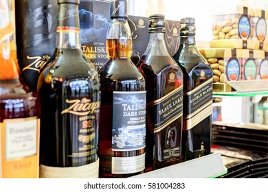 PALANGA AIRPORT, LITHUANIA - 09 FEBRUARY 2017: Duty free shop interior. Shelf with various alcohol drinks. Palanga International airport. Lithuania.