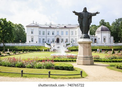 """PALANGA, LITHUANIA - August 04, 2017: The sculpture """"Blessing Christ"""" before the Amber Museum in resort town Palanga botany park."""