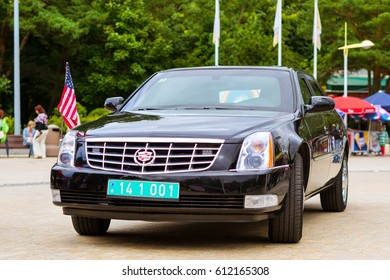 Palanga, Lithuania - August 11, 2012: Modern comfortable American car Cadillac with American flag on hood & diplomatic number parked on pedestrian promenade in Lithuanian resort town. Klaipeda county
