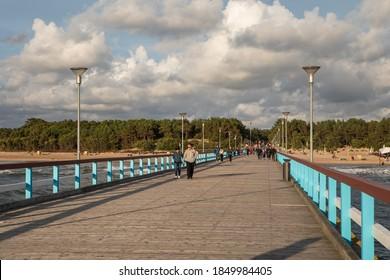 Palanga, Lithuania - July 11, 2020: People stroll on the Palanga pier (Palanga bridge) at the Baltic Sea in Palanga, Lithuania.