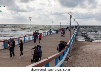 PALANGA,LITHUANIA-AUGUST 23, 2019:Boardwalk pier in Baltic Sea udnder cloudy sky, Palanga,Lithuania,Europe