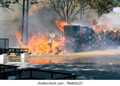Palatka, FL / USA - July 26, 2016: Burning Wood Chips in the storage area of a store. Fire was determined to be caused by weather conditions, not set intentionally.