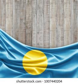 Palau flag of silk and wood background -3D illustration