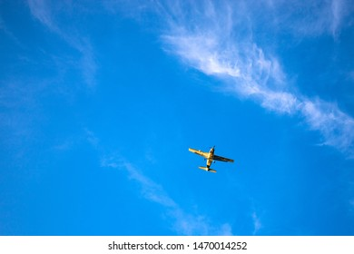 Palawan, the Philippines - 29 Nov 2018: small passenger aircraft in sunny blue sky. Personal airplane in blue skyscape. Minimalist landscape with airplane and clouds. Flight sport and activity banner