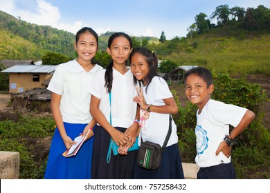 PALAWAN, PHILIPPINES - MARCH 28, 2016:  Children after school in their village on March 28, 2016, Palawan, Philippines.