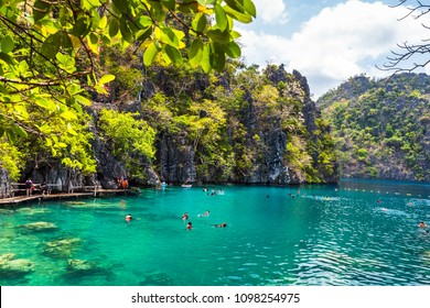 Palawan, Philippines - March 29, 2018. People tourists swimming at Kayangan Lake in Coron Island, Palawan, The Philippines.